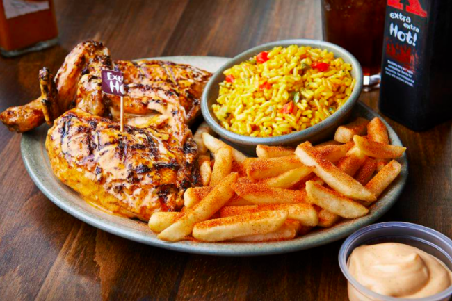Nando's extra hot chicken with french fries and rice